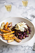 Burger with red cabbage slaw and sweet potato fries