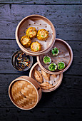 Various types of dim sum in a steamer basket (China)