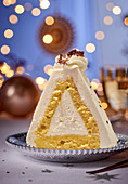 A Christmas sponge cream cake shaped like a pyramid