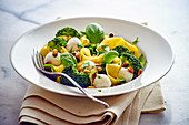 Papardelle with broccoli, mozzarella, basil and pine nuts