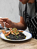 Black octopus risotto with seafood