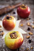 Apples filled with a marzipan, nut and raisin filling ready to bake in puff pastry