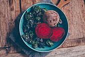 Beetroot on a blue plate with flower sprouts