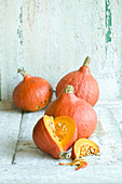 Hokkaido pumpkins against a white wooden background