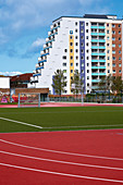 A view of pre-fab apartment buildings from a sports field, Evershagen, Rostock, Germany