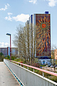 Apartment block on stilts with a giant sun relief, Evershagen, Rostock, Germany