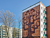 Apartment block with a giant tree relief, Evershagen, Rostock, Germany