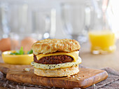 An English muffin burger with egg and cheese