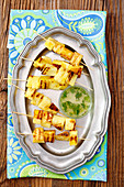 Grilled pineapple skewers with lime syrup