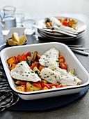 Haddock fillets on roasted vegetables