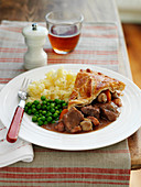 Beef and ale pie with mashed potatoes and peas (England)