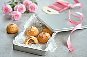 Almond cakes with chocolate filling in a gift tin