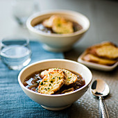 Four onion soup with red wine and Gruyere croutons