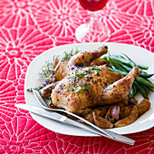 Roast chicken with potatoes, green beans, shallots and herbs