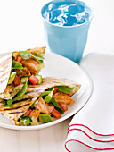 Grilled salmon and avocado pitta breads