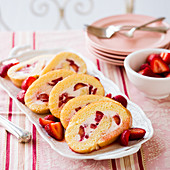 Strawberry and cream Swiss roll, sliced