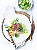 Gratinated saddle of venison with pear and celery purée