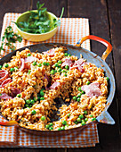 Fried red rice with tomatoes and peas