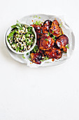 Sticky harissa chicken with couscous salad
