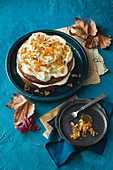 Pumpkin cake with cream cheese frosting and pecan nut brittle
