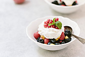 Summer fruits with whipped cream