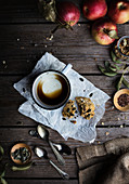 Pastry and cup of coffee on rustic wooden table