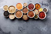 Various superfoods and cereal ingredients in small bowls