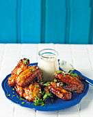 Sticky chicken wings with a blue cheese dip