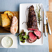 Rare roasted beef fillet with bread and sauce