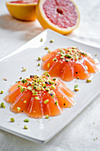 Pink grapefruit jelly with pistachio nuts