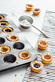 Mini apricot and raspberry jam tartlets