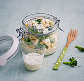 Pasta salad with hard-boiled egg, sweetcorn and herb cream cheese