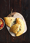 Spinach and ricotta calzone with caprese sauce