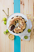 A chocolate custard wreath cake with lime and caramel sauce and almond brittle