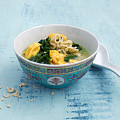 Oriental mie noodles with scrambled egg and spinach