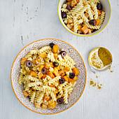 Pumpkin fusilli with black olives