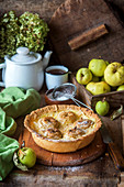 Apple pie with baked custard and whole apples