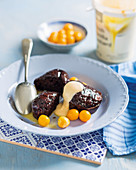 Chocolate malva puddings with white chocolate sauce and cape gooseberries