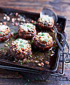 Stuffed mushrooms on a baking tray