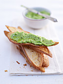 Pea puree spread on toasted bread