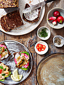 A Scandinavian Breakfast with crab meat on rye bread and mackerel on rye bread