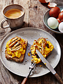 Truffled Mushroom Eggs on brown bread toast served with a coffee