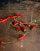 Red chili peppers on a rustic wooden background