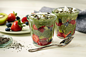 Matcha chia pudding with strawberries in glass jars