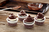 Peppermint patty cupcakes on a wooden background