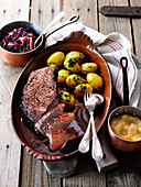 Braised roast beef in a red wine and chocolate sauce with elderberry red cabbage