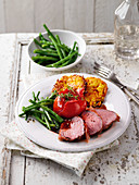 Beef fillet with green beans and potato and pumpkin fritters