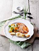 Smoked turkey on a bed of summer vegetables with a potato strudel bonbon