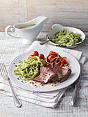 Roast beef with a creamy pepper sauce and herb Spätzle (soft egg noodles from Swabia)