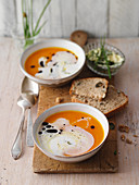 Pumpkin soup with pumpkin seed bread and herb butter